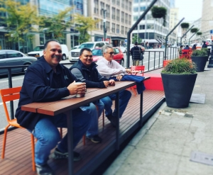 Kaua'i Mayor Bernard Carvalho Jr., Kaua'i County Planning Director Michael Dahilig and Kaua'i County Engineer Larry Dill enjoy a city parklet in Seattle.