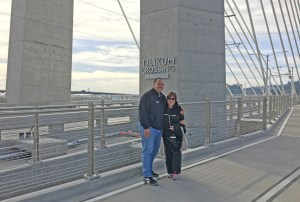 Kaua'i Mayor Bernard Carvalho, Jr. and Hawai'i County Council Vice Chair Valerie Poindexter pause while walking on the  Tilikum Crossing shared use bridge in Seattle.