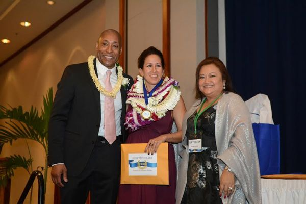 Dr. Juliette Zelada of Wilcox Memorial Hospital on stage receiving her 2015 Hawai'i Healthcare Hero award from (left) George Greene, Esq., President & CEO of the Healthcare Association of Hawai'i, and (right) Kathleen Libao-Laygo, RN, Director of Quality & Regulatory Affairs of the Healthcare Association of Hawai'i.