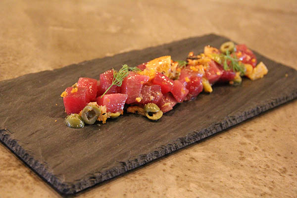 Crudo, from the Firsts section on the menu. What a flavor buster! We are used to ahi poke served Kaua'i style, but get ready for a twist. It's with Sicilian olives, burnt orange bits, Maui onions and red chili.