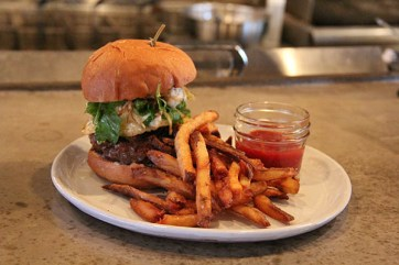 Street Burger, the restaurant's signature burger has a little bit of everything: cured pork belly, fried egg, arugula, blue cheese and fizzled onions.