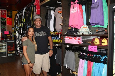 Tamba Surf Company owner Saa Tamba and employee Tessa Bueno.