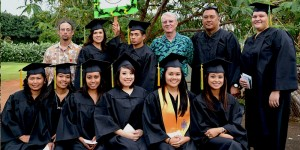 Wearing an aloha shirt, Jim Lally, the donor behind the program, poses with the graduating class.