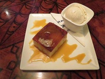 This Butter Mochi is served warm with Lappert's vanilla scoop and smothered in a tangy lilikoi glaze. This old family recipe and is, of course, made in house.