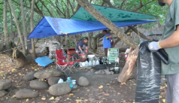 DLNR officers go through an illegal campsite in Kalalau. Video grab DLNR