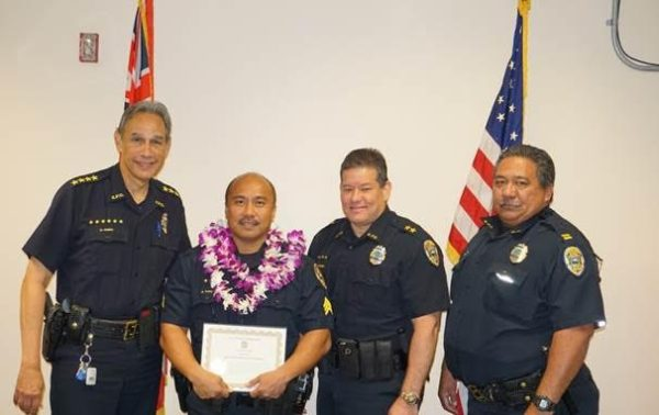 Photo, L-R: Kaua'i Police Chief Darryl Perry; Det. Bernard Purisima; Executive Chief Michael Contrades; Acting Assistant Chief of the ISB Richard Rosa.