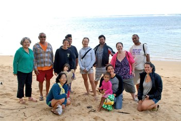 Kaiaulu students are seen here learning about the cultural and environmental history of 'Anini beach with long time residents walking along the coastline. Photo taken at Hololoa/Jerry's Channel at 'Anini Beach March 2015. Photo courtesy Mehana Vaughan