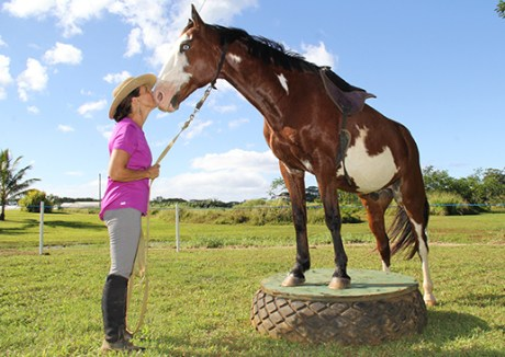 Marti Kitch shares a breath with Matisse, a Molokai horse.