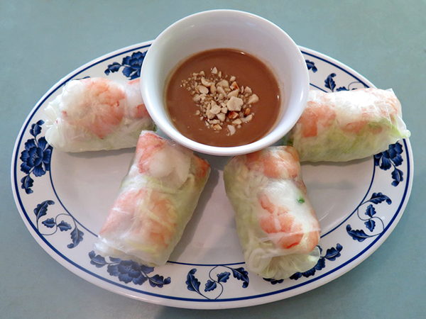 The Shrimp and Pork Summer Rolls are wrapped in rice paper. Veggies are crunchy and fresh. This is a cold starter. I can't get enough of the house made peanut butter sauce, which is light and subtle.