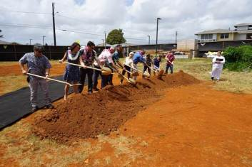 Officials take part in the ceremonial shoveling of the dirt at Friday's Kaniko'o Phase II groundbreaking. From L-R: Department of Water Manager Kirk Saiki; Vitus Development Owner Makani Maeva; Milo Spindt, Kaua'i Board Member of HHFDC; Bill Bow, Bow Engineering and Development; Mayor Bernard Carvalho Jr.; Councilwoman JoAnn Yukimura; Housing Development Coordinator Gary Mackler; Project Manager for Kaniko'o Helito Caraang of Shioi Construction; Housing Director Kanani Fu; Scott Settle of Settle Meyer Law; and Kahu Jade Wai'ale'ale Battad.