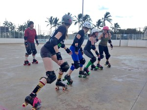 Lined up on the jammer line for the start of a drill are Chilly Pepper, The Carnie, Laurengitis, and Michelle O. Bomber getting ready for Hawaiian Punch the jam.