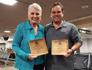 Barbara Bennett, For Kaua'i owner and publisher, and For Kaua'i editor in chief Léo Azambuja at Honolulu Airport on their way back from O'ahu with two Society of Professional Journalists awards June 24.