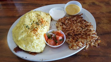 Bacon and Avocado omelet, served with Hollandaise sauce. Add a side of homemade salsa and it's heaven.
