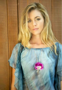 Samantha Lockwood is also the creator and designer of  Fleurings, a unique line of vase jewelry, a collection of earrings, necklaces and hairpieces designed to hold water and keep flowers fresh.
