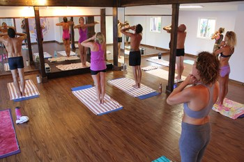 Bikram Yoga classes last 90 minutes in a heated room. Students to 26 postures, half standing, half on the floor.