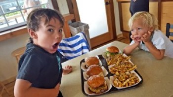 Kauluwai Yamashita, left, and brother Nohokai Yamashita, visiting from Molokai, get ready to dive into a couple of burgers at Kenji Burgers in Kapa'a, Kauaʻi's Eastside.