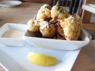 The Crispy Cauliflower, seasoned and lightly breaded, could be the new alternative to fries, served with a light dipping sauce. Definitely add that squeeze of lemon for a fun bite.