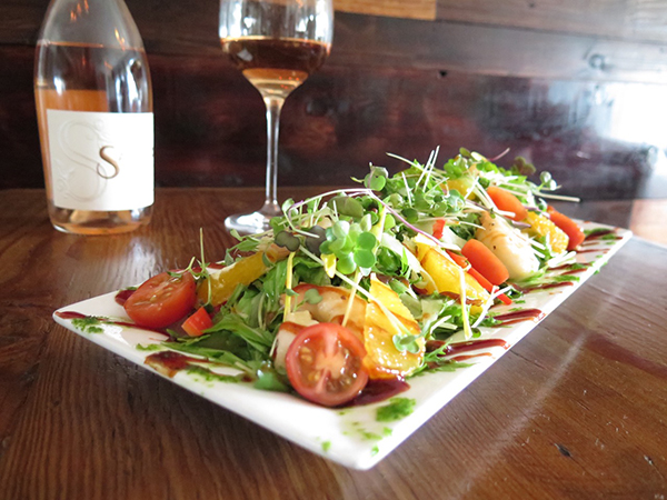 The evening's salad special, Mizuna and watercress with local greens and veggies with mizo-glazed prawns and green papaya. It's pictured with a rosé. Rosé wines are making a comeback and Palate features four quality rosés. It matched well with the meat salad, as it offered a heavier flavor than a white, which is a more traditional choice for salad.
