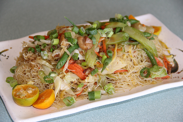 Pancit is a the name for noodles in Filipino cuisine. Fried rice noodles are served with stir fried local vegetables and your choice of chicken or pork. This was one of my favorite dishes.