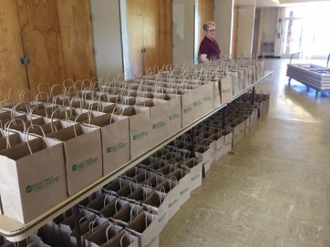 Energy Services Supervisor Kathryn Williams helps prepare goodie bags for attendees