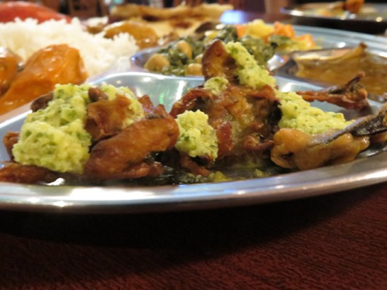 Vegetable Pokora, drizzled with a mint sauce. I really enjoyed these. They are all sorts of vegetables breaded and fried, and they remind me of fritters. The mint sauce is served cool on the side, and though it's cool and minty it has some heat. I'm sure you could drizzle it on anything.