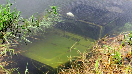 The green Jeep submerged in Wainiha River. Photo courtesy of Kaua'i County