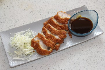 The Tonkatsu is marinated pork, fried with panic breading, then sliced. The breading is light and crispy without a hint of oil. Dipped in a housemate sauce it is delicate, not a word I usually assign to pork dishes.