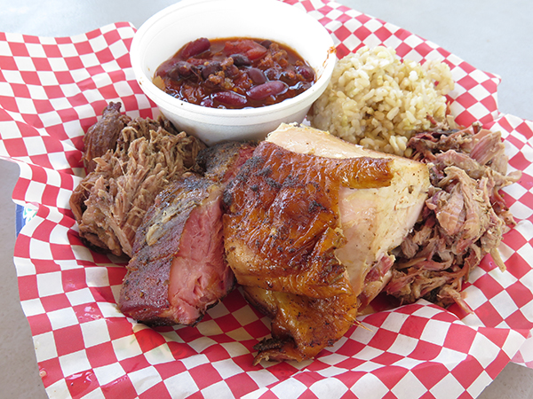 The combo plate comes with, left to right, pulled pork, ribs, chicken and beef roast. It comes standard with chili and brown rice, but substitute it by coleslaw if you want. Note, almost everything on the menu is naturally gluten-free.
