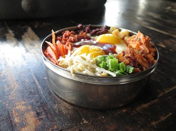 "mchi Fried Rice, which I looked at like a ""deconstructed fried rice,"" is actually a bibimbap preparation. Be sure to mix everything together to get the full experience."
