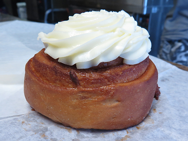 A cinnamon roll, but even better, topped with cream cheese frosting.