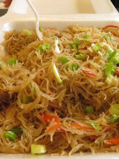 Pancit. A Filipino dish of rice noodles, crisp veggies, egg and chicken that you can find on the box lunch menu under Chicken. The rice noodles are surprisingly delicate, light and airy, and hold flavor well. Add your choice of soy or hot sauce to make it zing.