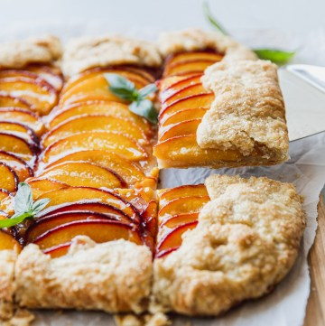lifting peach galette with server