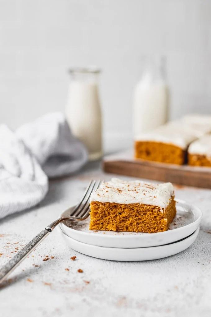 pumpkin bar on plate with fork next to platter
