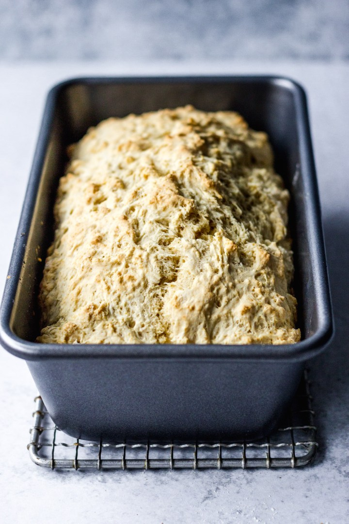 beer bread in loaf pan by fork in the kitchen