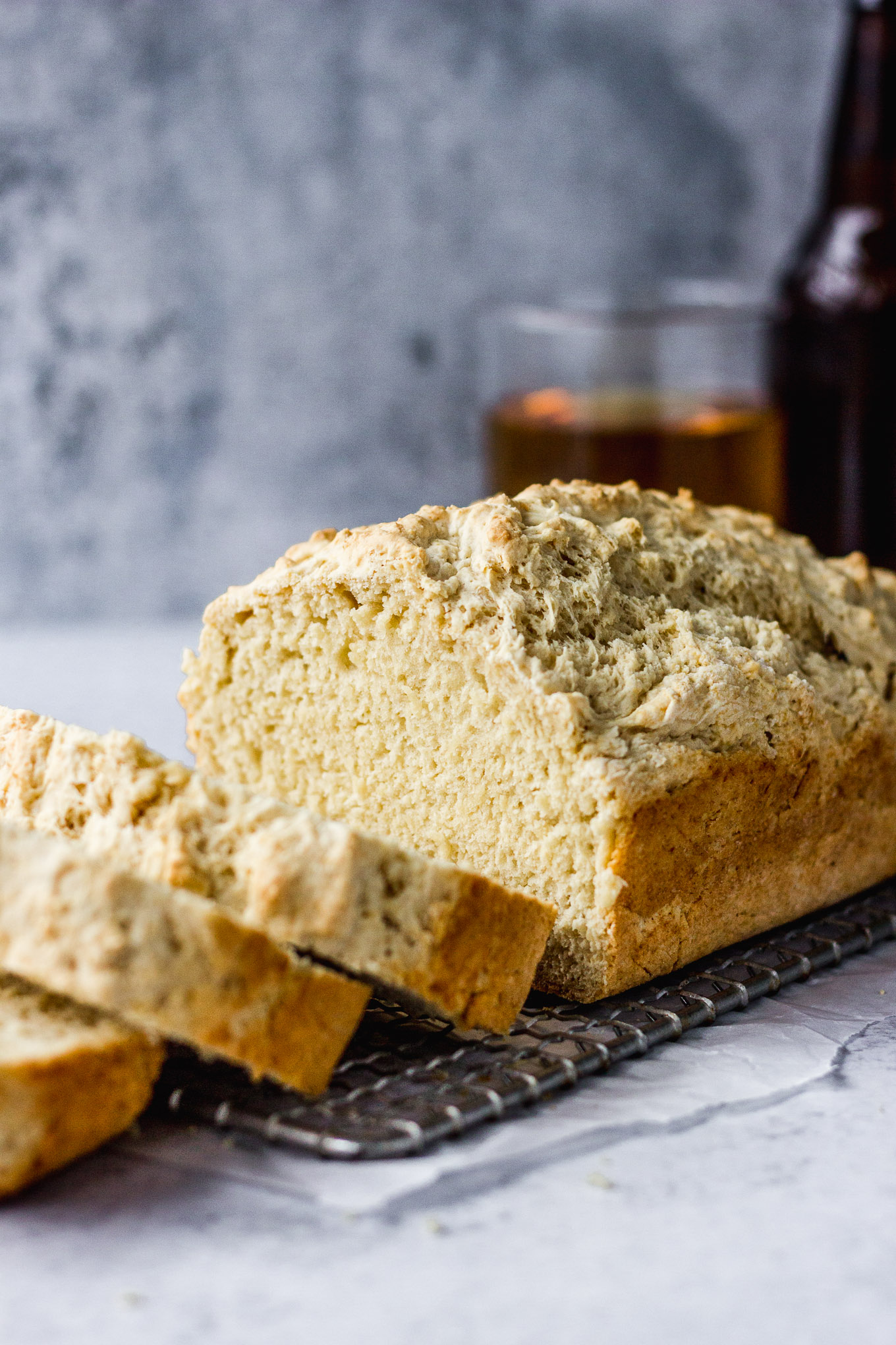 beer bread loaf sliced next to beer