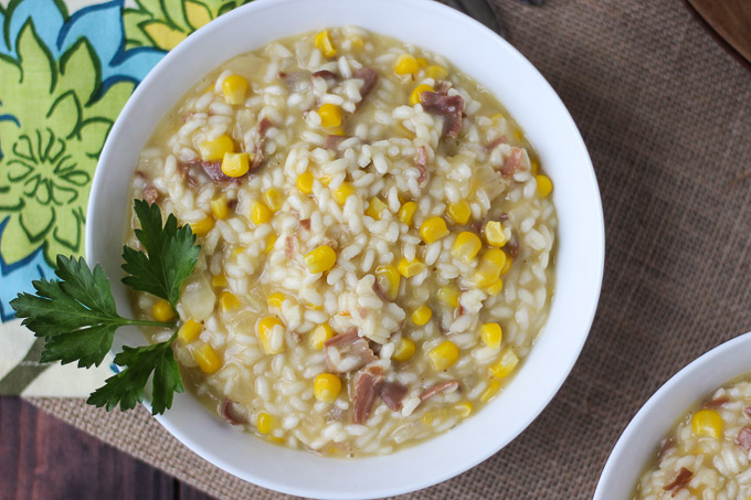Corn and Prosciutto Risotto is full of creamy decadence, balanced out with salty prosciutto and sweet pieces of corn.