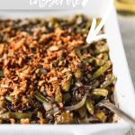 up close scoop of wild rice casserole in baking dish