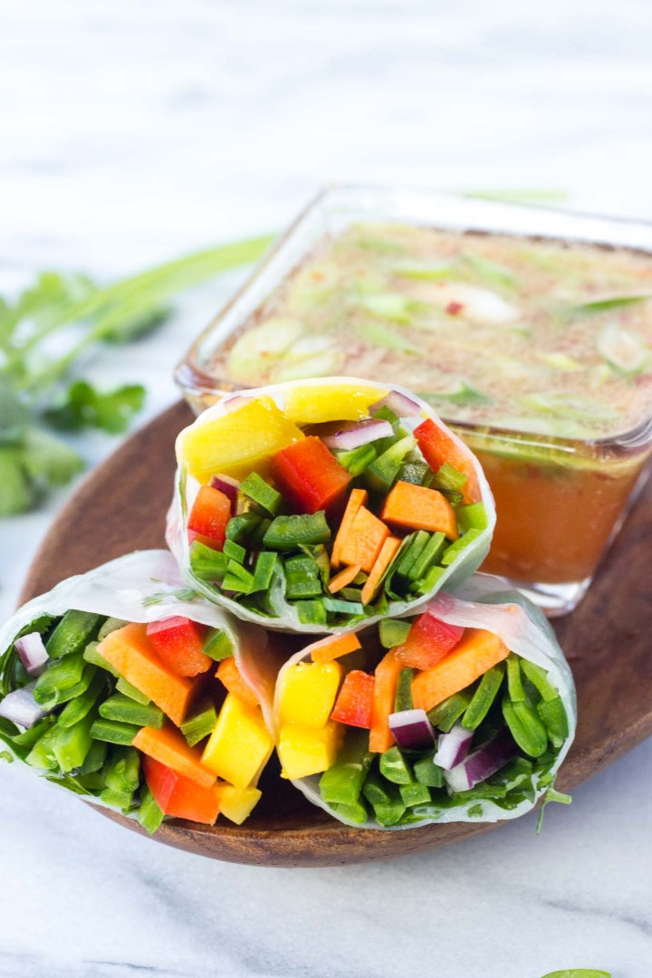 Mango Salsa Spring Rolls - all the favorites from mango salsa rolled up in a spring roll; bursting with sweet and spicy, mega fresh flavor, these are prefect to serve as an appetizer! // Fork in the Kitchen