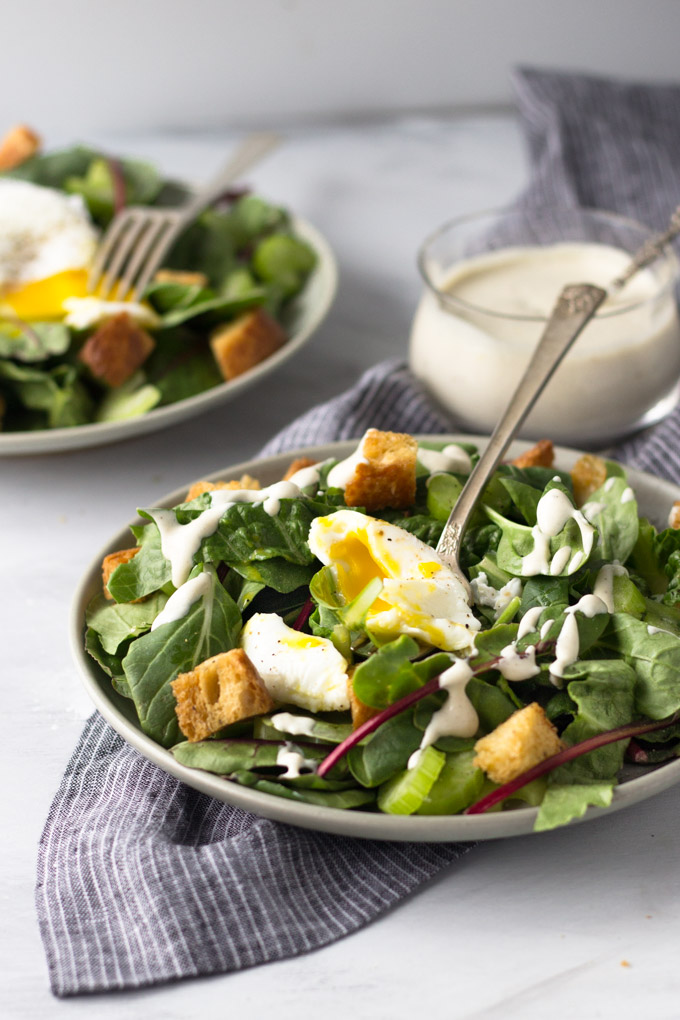 Simple Dijon Salad - a tangy dressing drizzled over a bed of lettuce with a perfectly poached egg and crunchy croutons! Simple, delicious dinner! | Fork in the Kitchen