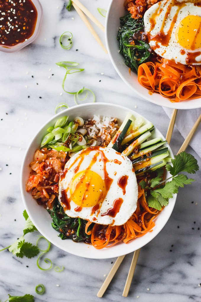 Spicy Vegetarian Bibimbap - A bowl of chewy rice, sautéed veggies, a flavorful gochujang sauce, and a creamy fried egg! Customizable, and perfect for a weeknight dinner! | Fork in the Kitchen
