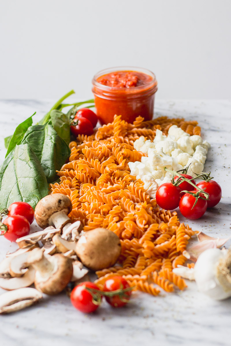 vegetable baked pasta ingredients by fork in the kitchen