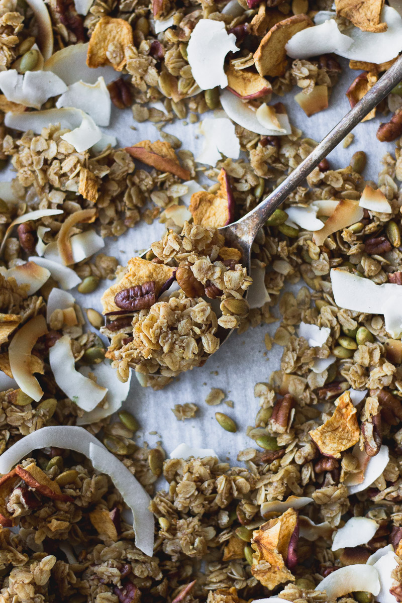 easy autumn spice granola overhead on baking sheet by fork in the kitchen
