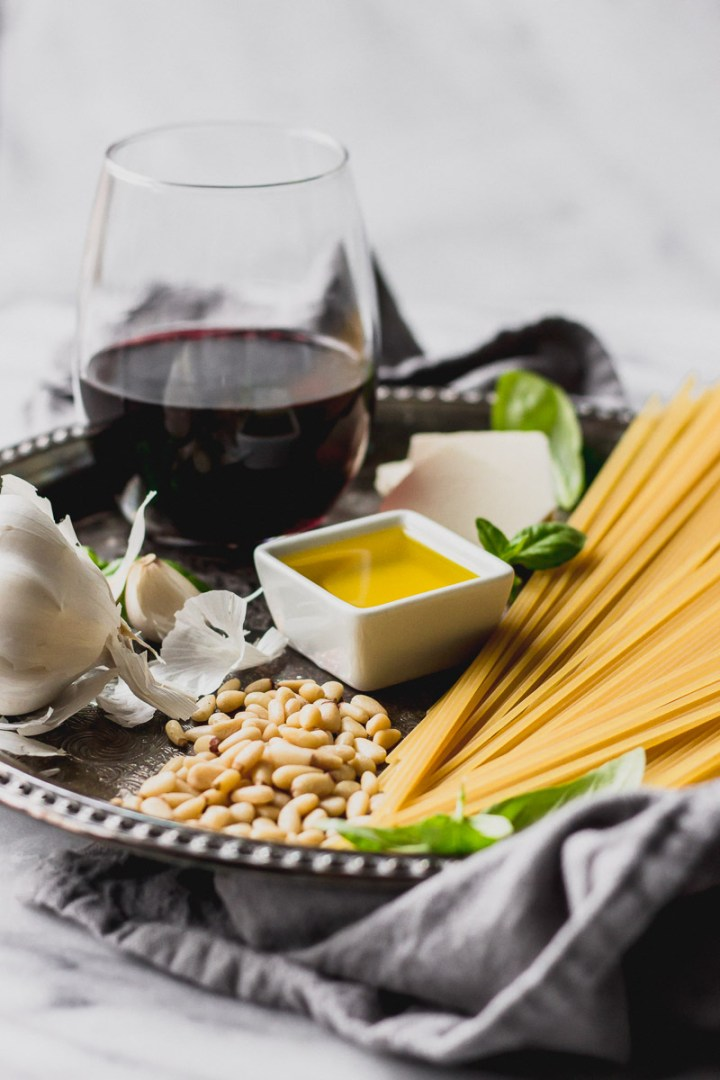 red wine spaghetti ingredients on platter by fork in the kitchen