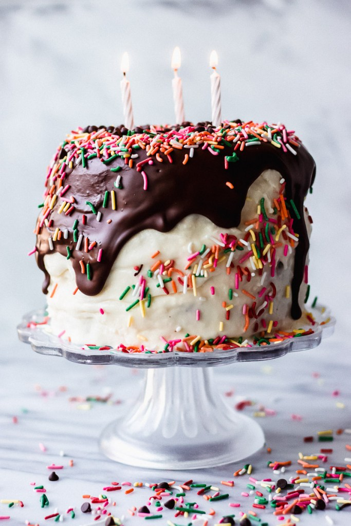 Mini Chocolate Cake with Sour Cream Frosting with chocolate and sprinkles on tray | Fork in the Kitchen