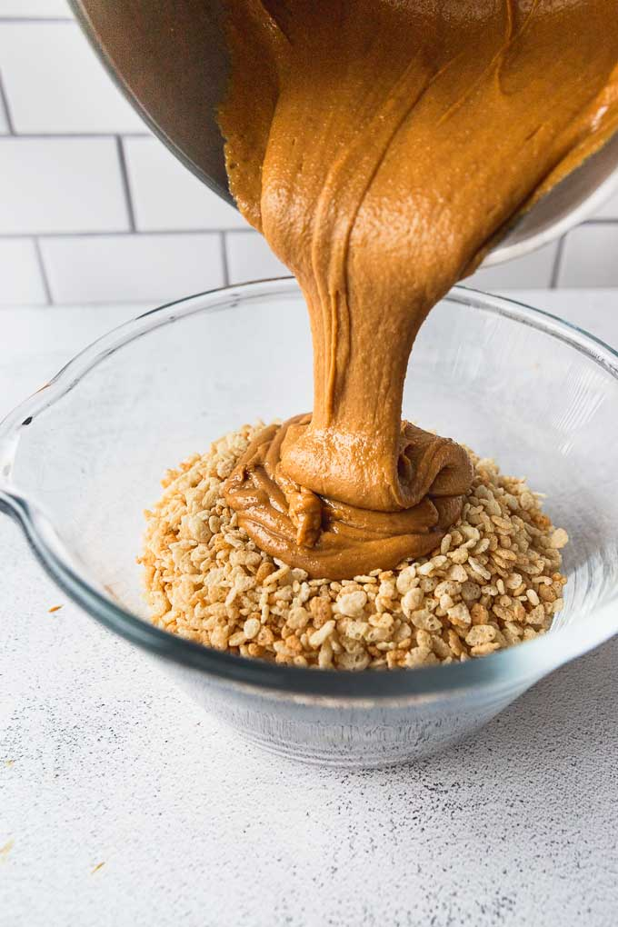 pouring peanut butter into rice krispie bowl