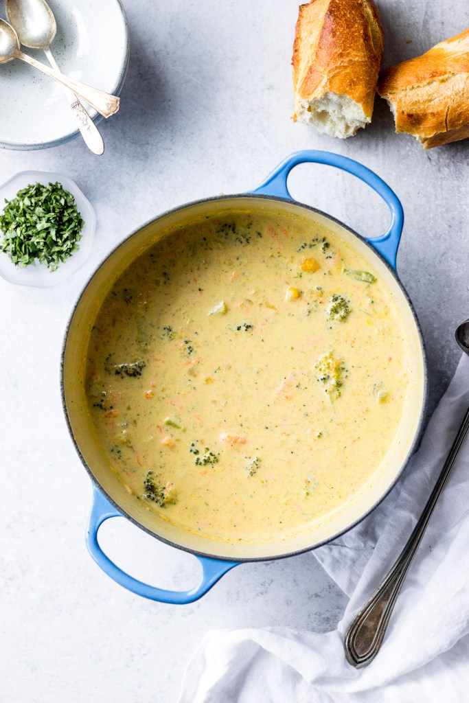 broccoli cauliflower cheddar soup in dutch oven by fork in the kitchen