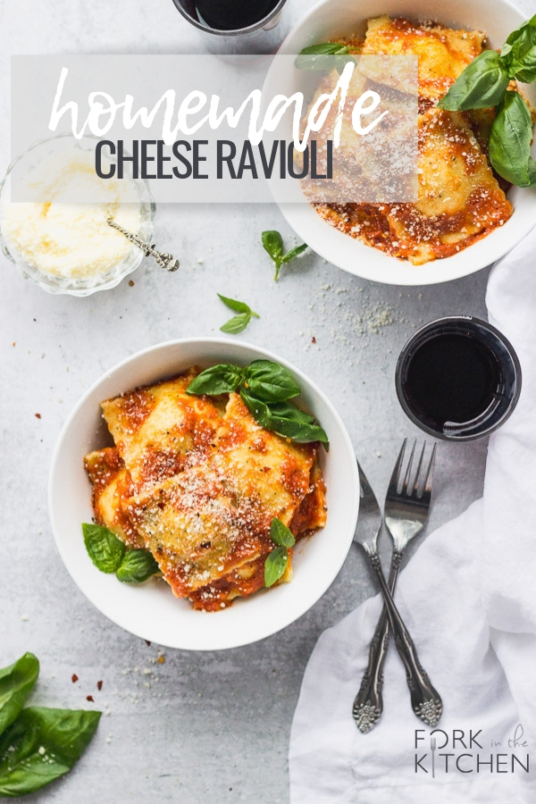 homemade cheese ravioli in white bowls with wine by fork in the kitchen