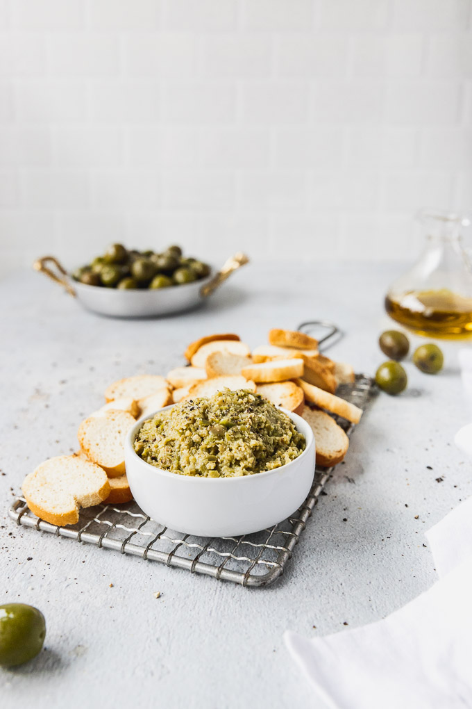green olive tapenade with baguette crisps