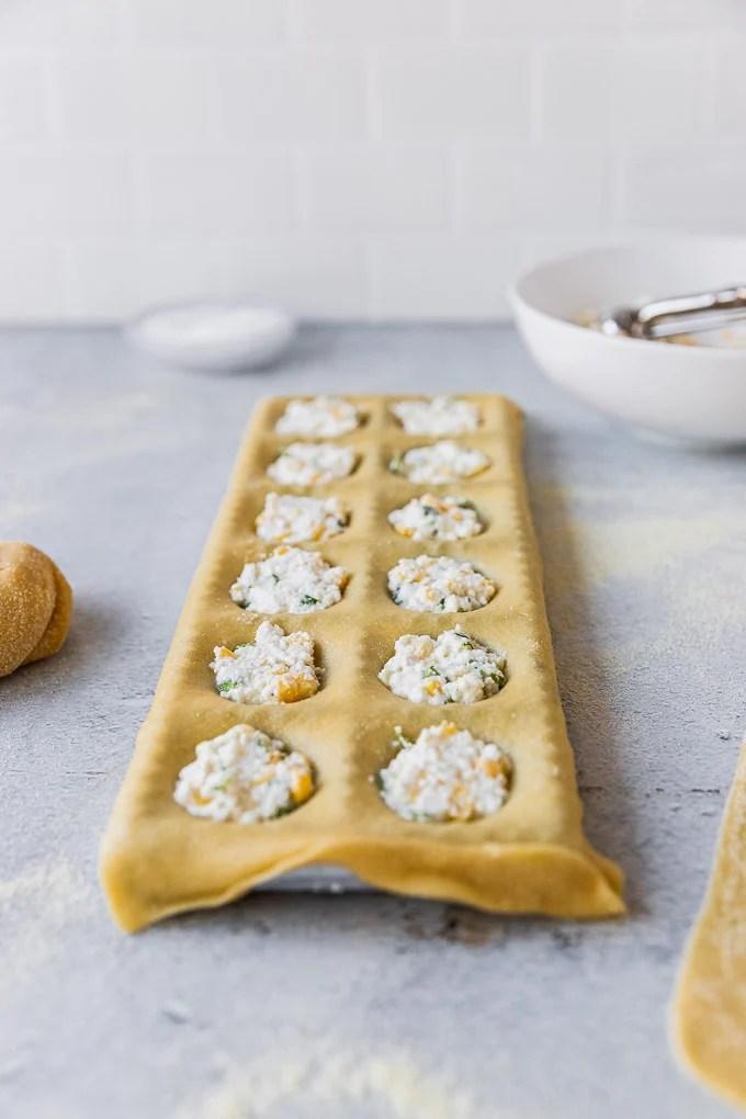 ravioli mold filled with ricotta ravioli filling