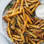 rosemary garlic fries on plate with aioli